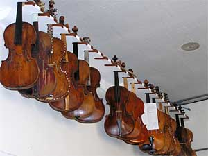 Several of these instruments date back to the 1700s.  They hang near the ceiling of Andrew Dipper's workshop at Claire Givens Violins.