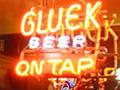 A neon sign promoting Gluek's beer at Gluek's Bar
