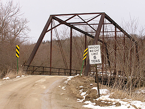Rural bridges like this one can have specific weight restrictions.  A Minnesota law passed 14 years ago exempts farm vehicles from size, weight and load provisions on all roads except interstates. Farms have grown since 1993, and so have the farm vehicles.