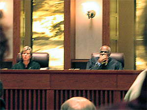 Justices Helen Meyer and Alan Page listen to the tobacco fee/tax arguments on April 11, 2006.