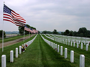 Flags line the graves, Ft. Snelling Natl Cemetery. The cemetery workers put up 550 American flags for Memorial Day.