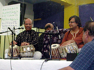 Tabla virtuoso Ustad Shabbir Nisar, left, was flown in especially for the workshop on Indian music. On the right is Allalaghatta Pavan.