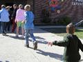 Charging toward the schoolhouse door