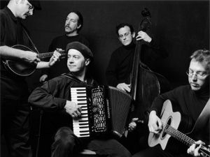Members of the the Cafe Accordion Orchestra.  Eric Mohring on mandolin, fiddle and vocals, Joe Steinger on percussion, Eric Mohring, Dan Newton on accordion and vocals, Erik Lillestol on bass, and Brian Barnes on guitar and vocals.