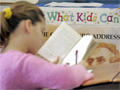 a fifth grade student  works on a book report