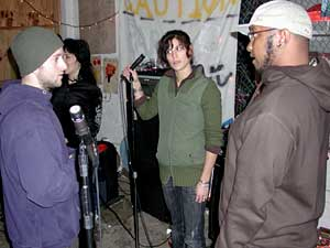 Three of Doomtree's band members at a recent rehearsal. Left to right:  Sims, Dessa, P.O.S.