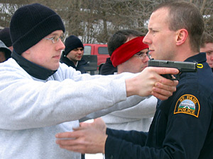 Recruit Charlie Anderson is advised by an instructor at the firing range.