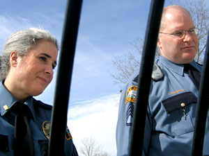 Instructors Anne Bebeau and Sgt. Jim Ramstad peer into a squad car before sending recruits off on a traffic stop.