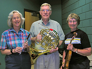 Joan Newmark, flute; Jim Cheeseman, French horn, and Marion Owens, violin, have played in the 3M Club Symphony Orchestra for a combined total of more than 100 years.