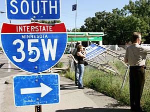 People take pictures of a section of the I-35W bridge that collapsed in Minneapolis.