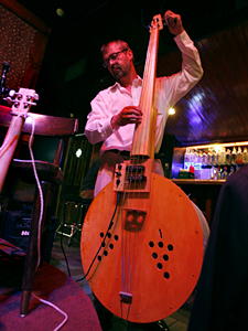 Washtub bass player Jon Olson tunes up before the Roe Family Singers perform at the 331 Bar in northeast Minneapolis.