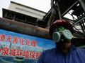 Chinese laborer works on emission system
