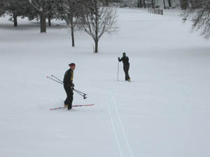 Cross-country skiers in St. Paul, Minn., take advantage of the season's first snowfall.