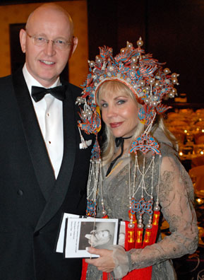 ... wearing a Chinese headdress at the Chinese Community Center gala. Colt