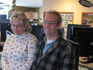 Vickie and Les Milverstedt like what they see on the digital TVs at Robert Paul TV in Roseville.