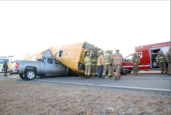 Four students were killed Tuesday after a van crashed into a bus near Cottonwood, Minn.
