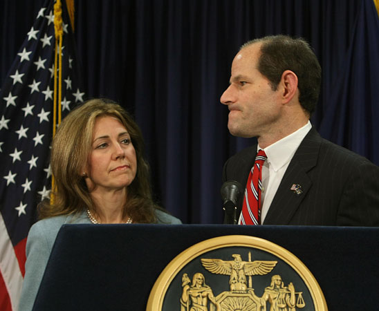 New York Gov. Eliot Spitzer holds a news conference Monday in New York City with his wife Silda by his side after it was announced that he has been involved in a prostitution ring.