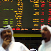 Traders at the Kuwait Stock Exchange