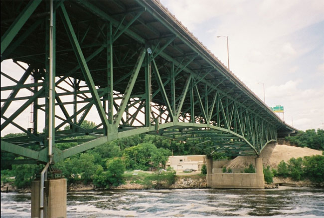 In this NTSB photo, A view of the east side of the deck truss portion of the bridge, looking northwest.