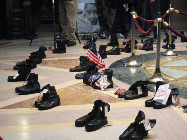 "The combat boots on display in the Capitol Rotunda are part of the exhibit ""Empty Boots: The Cost of War.""   Each pair represents a military member who has died in combat in Iraq and Afghanistan."