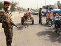 An Iraqi police commando stands guard