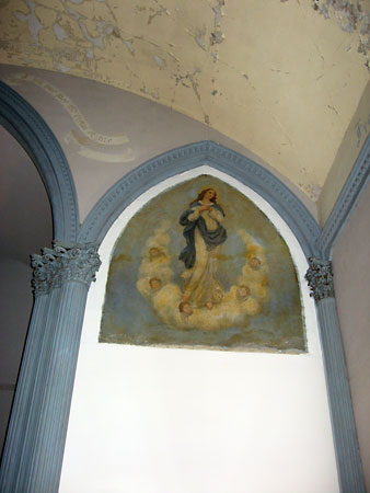 A painting of the Virgin Mary, near the front of the church.