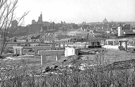 Construction of Interstate 94 near 6th St. in downtown St. Paul, 1960, destroyed the predominantly African American Rondo neighborhood.
