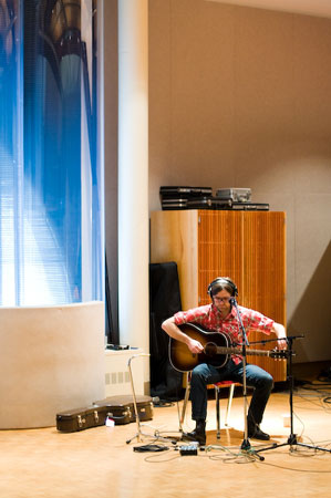 Ben Gibbard of Death Cab for Cutie tuning up in the Maude Moon Weyerhaeuser studio