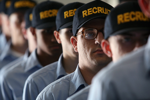 Navy recruits stand at attention during training at The Great Lakes