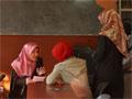 Women read from the Koran