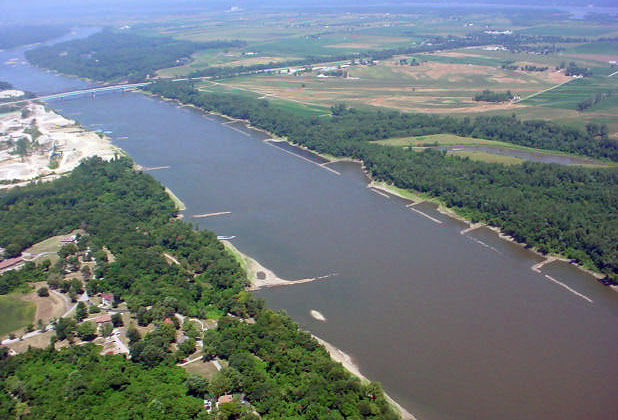The Missouri River north of St. Louis during the low flow conditions of July 31, 2002. Note the prominent wing dams located every 600 to 1200 feet along both sides of the river; the tree line on the north side marks the approximate position of a levee.
