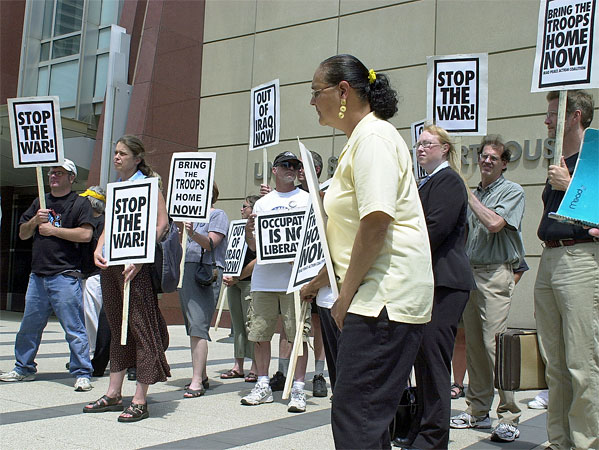 Angella Kahn, center, joined several other protesters outside the federal courthouse in Minneapolis in July to voice their objections to marching restrictions in St. Paul during the Republican National Convention.