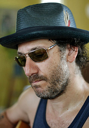 Adam Levy of The Honeydogs says he probably wrote his first song at 14. By college, he didn't write songs; instead, he studied them.  He received a degree in