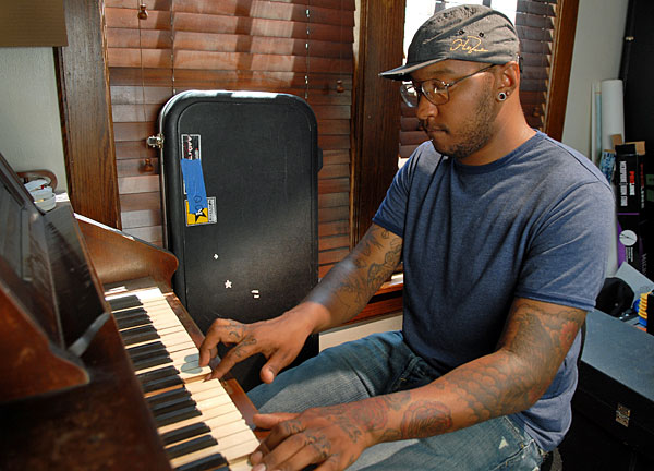 P.O.S. at his pump organ. He draws from a broad palette of sounds for his rap tunes.