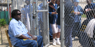 Inmate Bernard Moss holds the line at the gate.