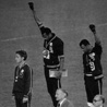 Tommie Smith (center) and John Carlos (right)