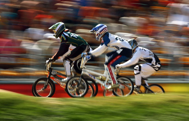 (L-R) Sifiso Nhlapo of South Africa, Mike Day of the United States and Marc Willers of New Zealand compete in the Men's BMX semifinal run held at the Laoshan Bicycle Moto Cross Venue during Day 14 of the Beijing 2008 Olympic Games on August 22, 2008 in Beijing, China.
