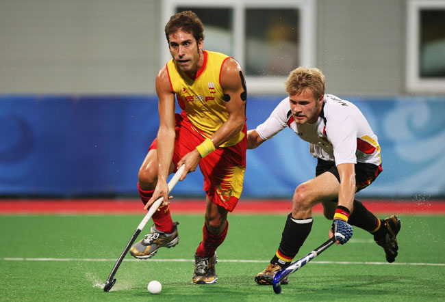 Eduard Tubau of Spain and Maximilian Mueller of Germany compete for the ball in the Men's Gold Medal Match between Germany and Spain held at the Olympic Green Hockey Field on Day 15 of the Beijing 2008 Olympic Games on August 23, 2008 in Beijing, China.
