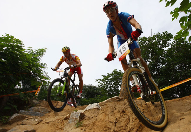 (L-R) Jose Antonio Hermida of Spain and Jaroslav Kulhavy of Czech Republic compete in the Men's Cross Country mountain bike cycling event held at the Laoshan Mountain Bike Course on Day 15 of the Beijing 2008 Olympic Games on August 23, 2008 in Beijing, China.
