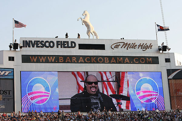 Musician Stevie Wonder is shown on a large stadium screen on day four of the Democratic National Convention (DNC) at Invesco Field at Mile High August 28, 2008 in Denver, Colorado. U.S. Sen. Barack Obama (D-IL) is the first African-American to be officially nominated as a candidate for U.S. president by a major party.  (Photo by Justin Sullivan/Getty Images)