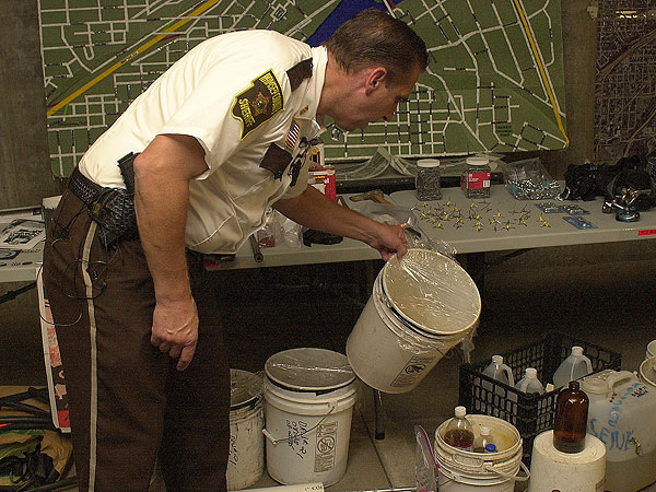 Ramsey County Sheriff Bob Fletcher displayed what he said were buckets of urine protesters planned to throw at police during Republican National Convention demonstrations.