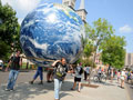 Protesters carry giant globe