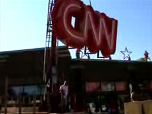 Workers hang a CNN sign on the facade of the Eagle Street Bar & Grill in downtown St. Paul.