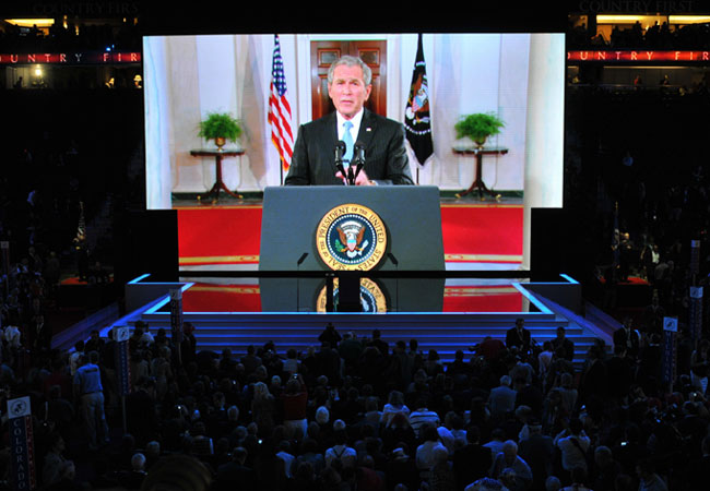 US President George Bush addresses the audience via a live video feed from the White House during the Republican National Convention at the Xcel Energy Center in St. Paul, Minnesota, on September 02, 2008.
