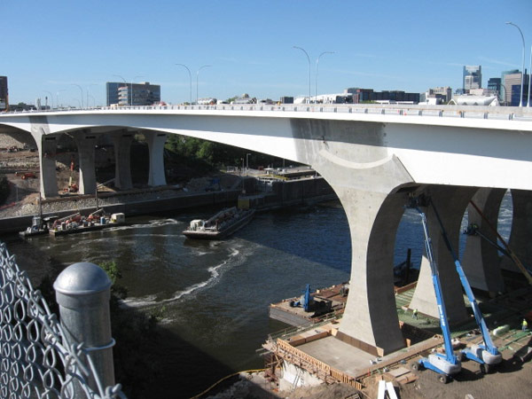 The Interstate 35W bridge nears completion, just over a year after the original span collapsed on August 1, 2007.