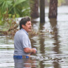 Texas resident wades through high water from Ike.
