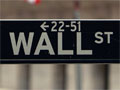 Wall St. sign next to the New York Stock Exchange