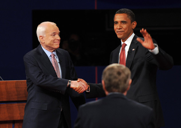 Republican presidential nominee John McCain (L) and Democratic presidential nominee Barack Obama (R) arrive on stage for the first presidential debate September 26, 2008 in Oxford, MS.