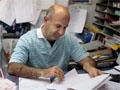Micheal Steiner overlooks paperwork at his office.