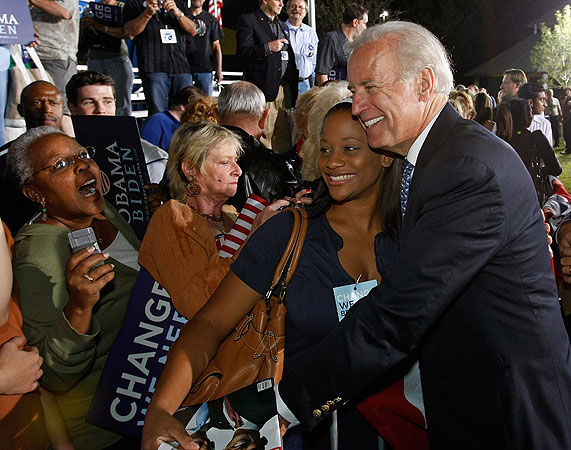 Democratic vice presidential candidate U.S. Senator Joe Biden (D-DE) takes a photo with supporter Love Barnett (2nd-R) of Nevada after he spoke at a rally at Morrell Park October 17, 2008 in Henderson, Nevada.